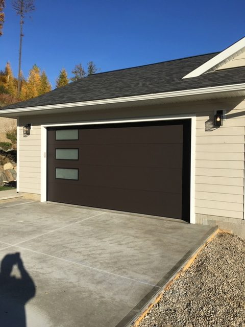 Brown Garage Door with Glass Inserts