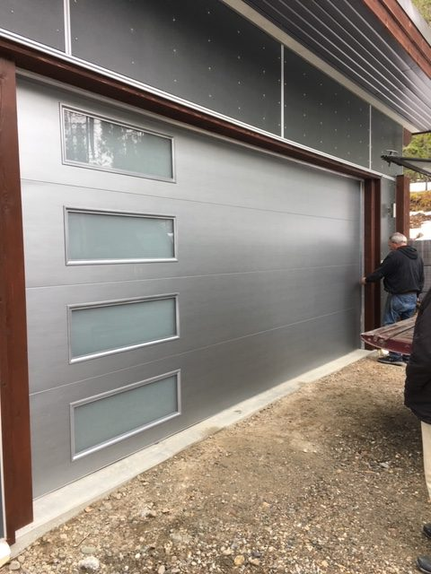 Grey Residential Garage Door with Glass Inserts